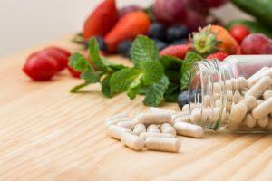 Serrapeptase capsules in bottle spilling on table