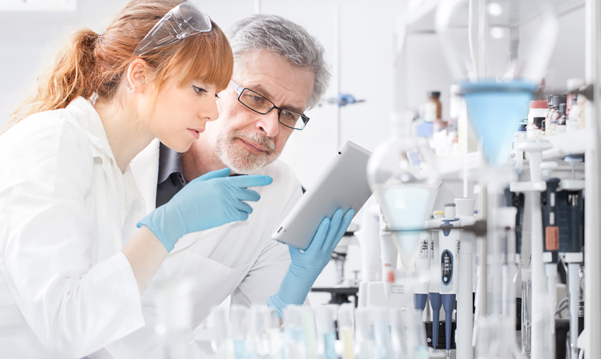 lab technicians studying results